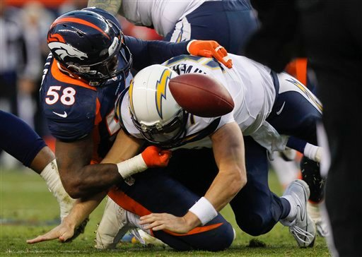 © San Diego Chargers quarterback Philip Rivers (17) fumbles the ball as he is sacked by Denver Broncos outside linebacker Von Miller (58) in the third quarter of an NFL football game, Sunday, Nov. 18, 2012, in Denver.