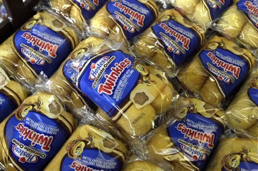 FILE - In this Friday, Nov. 16, 2012, file photo, Twinkies baked goods are displayed for sale at the Hostess Brands' bakery in Denver, Colo. (AP Photo/Brennan Linsley)