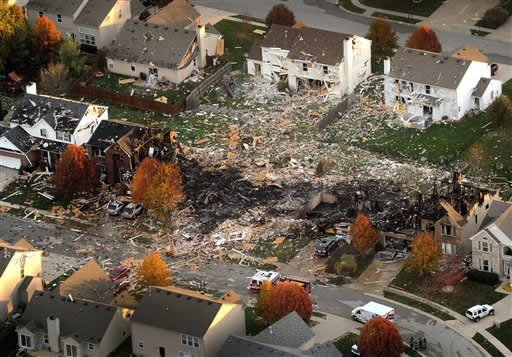 FILE - This aerial file photo from Nov. 11, 2012, shows the two homes that were leveled and the numerous neighboring homes that were damaged from a massive explosion that sparked a huge fire and killed two people in Indianapolis. (AP Photo)