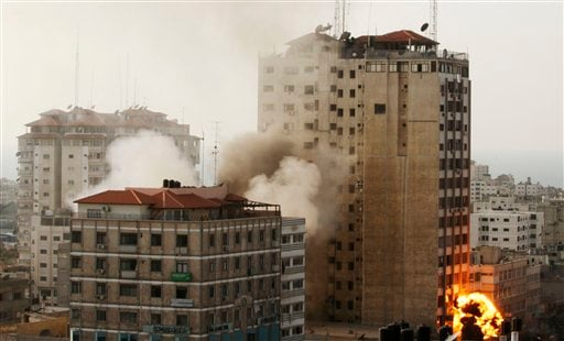 Smoke and fire are seen from an explosion by a high rise housing media organizations in Gaza City, Monday, Nov. 19, 2012. It's the Israel's military second strike on the building in 2 days. The Hamas TV station, Al Aqsa, is located on the top floor. (AP)