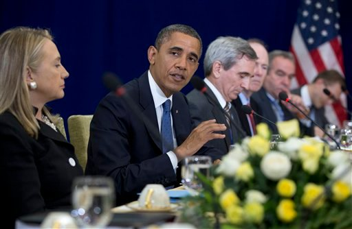 © U.S. President Barack Obama, second from left, speaks as he meets with Japan's Prime Minister Yoshihiko Noda during the East Asia Summit at the Peace Palace in Phnom Penh, Cambodia, Tuesday, Nov. 20, 2012.