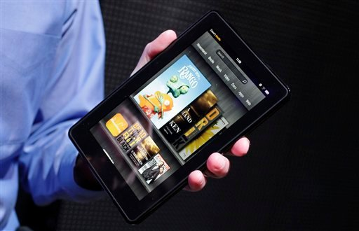 © This Wednesday, Sept. 28, 2011 file photo shows the Kindle Fire at a news conference in New York.