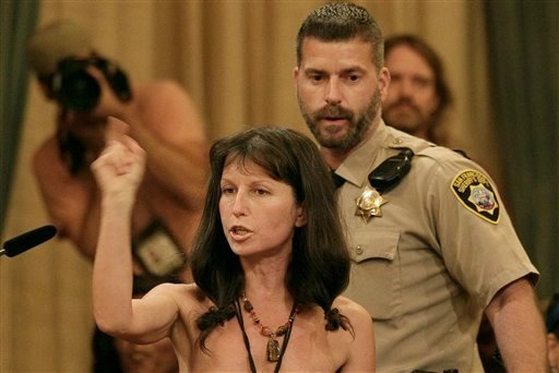 Protester Gypsy Taub speaks out against the Board of Supervisors decision to ban public nakedness while naked at City Hall in San Francisco, Tuesday, Nov. 20, 2012. (AP Photo/Jeff Chiu)