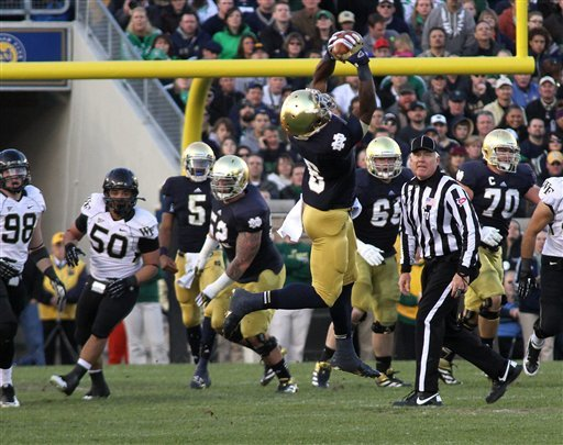 Notre Dame's Theo Riddick makes a catch down the field for the Irish against Wake Forest during an NCAA college football game Saturday Nov. 17, 2012 in South Bend, Ind. (AP Photo/ The Goshen News, Sam Householder)