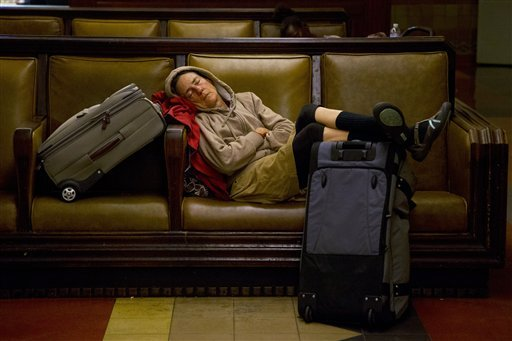 A traveler sleeps at Union Station in Los Angeles, Wednesday, Nov. 21, 2012. (AP Photo/Jae C. Hong)