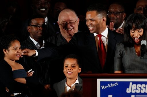 FILE - This March 20, 2012 file photo shows Rep. Jesse Jackson Jr., D-Ill., his wife Chicago Alderman Sandi Jackson, and their children Jessica, 12, and Jesse III, 8, thanking supporters at his election night party in Chicago. (AP Photo)