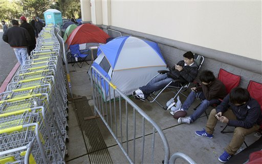 Shoppers wait in line outside of a Best Buy store in Colma, Calif., Thursday, Nov. 22, 2012. (AP Photo/Jeff Chiu)