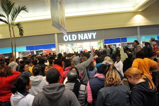 A large crowd of shoppers waits outside an Old Navy store just after midnight during Black Friday shopping at Oglethorpe Mall in Savannah, Ga. on Friday, Nov. 23, 2012. (AP Photo/The Morning News, Richard Burkhart)