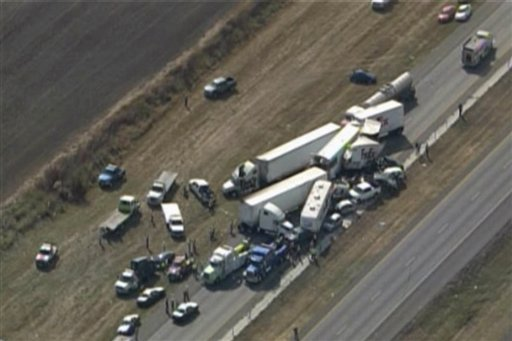 © In this image provided by Click2houston.com cars and trucks are piled on Interstate 10 in Southeast Texas Thursday Nov. 22, 2012.