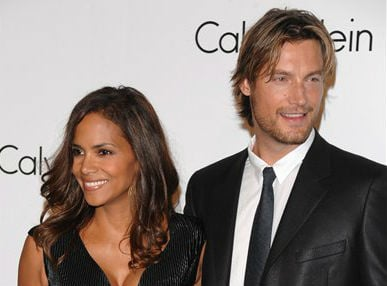 © In this Sept. 7, 2008 file photo, Model Gabriel Aubry and actress Halle Berry attends the Calvin Klein 40th anniversary party during Fashion Week in New York.