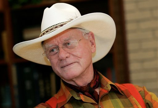 """In this Thursday, Oct. 9, 2008 photo, actor Larry Hagman listens to a reporter's question while visiting the Southfork Ranch in Parker, Texas, made famous in the television show """"Dallas."""" (AP Photo/Tony Gutierrez)"""