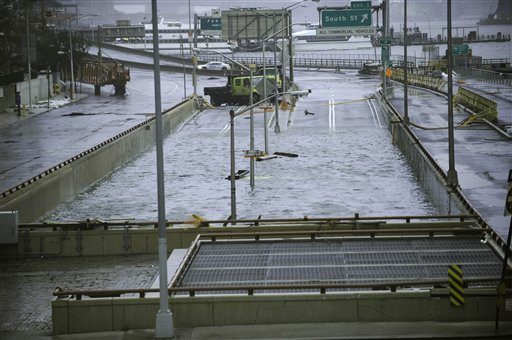 © This Oct. 30, 2012 file photo shows water reaching the street level of the flooded Battery Park Underpass, Tuesday in New York, remnants from Superstorm Sandy.