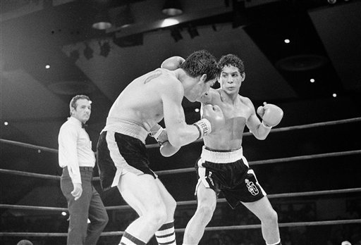 © In this July 11, 1982 file photo, Luis Loy Jr., left, ducks under a blow by Hector Camacho early in a scheduled 10-round junior lightweight boxing bout at Felt Forum in New York.