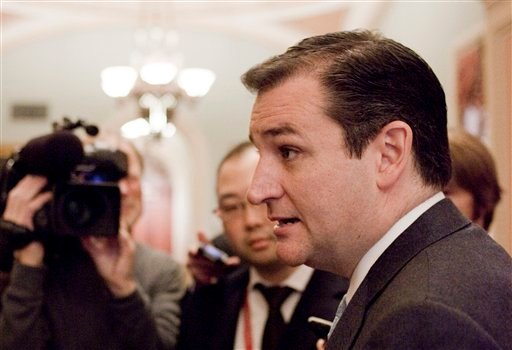 ©  This Nov. 13, 2012 file photo shows Sen.-elect Ted Cruz, R-Texas speaking to reporters on Capitol Hill in Washington.