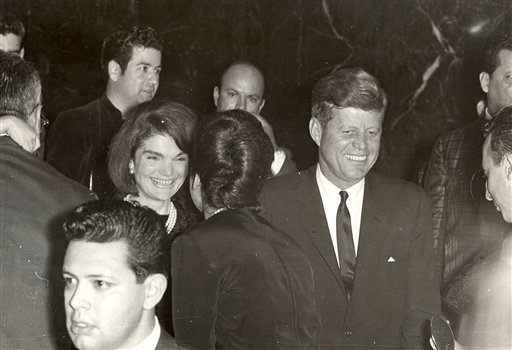 © This image provide by Alexander Arroyos, taken on Nov. 21, 1963, shows President John F. Kennedy and first lady Jacqueline Kennedy greeting Latino activists at a LULAC gala in Houston's Rice Hotel.