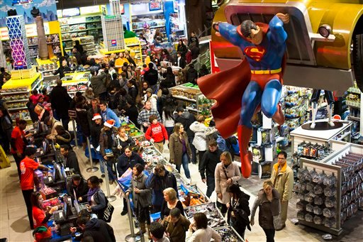  In this Thursday, Nov. 22, 2012, file photo, shoppers wait on a check-out line in the Times Square Toys-R-Us store after doors were opened to the public at 8 p.m., in New York.