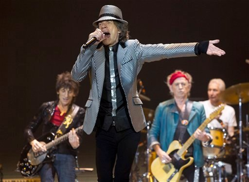 © Mick Jagger, front centre, Ronnie Wood, left, with Keith Richards and Charlie Watts, right, of The Rolling Stones perform at the O2 arena in east London, Sunday, Nov. 25, 2012.