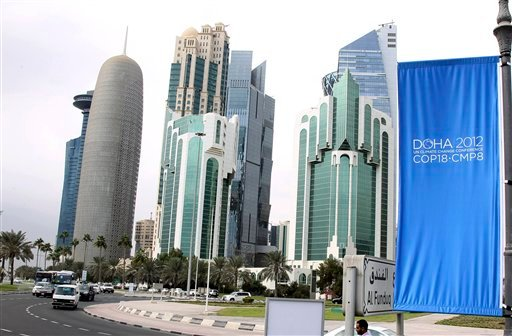 © In this Wednesday, Nov. 20, 2012 file photo, conference flags are displayed ahead of the Doha Climate Change Conference, in Doha, Qatar.