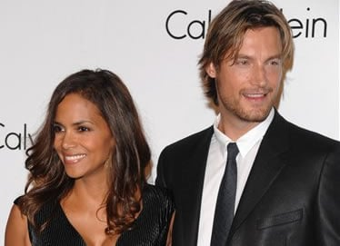 FILE - In this Sept. 7, 2008 file photo, Model Gabriel Aubry and actress Halle Berry attends the Calvin Klein 40th anniversary party during Fashion Week in New York. (AP Photo/Peter Kramer, File)