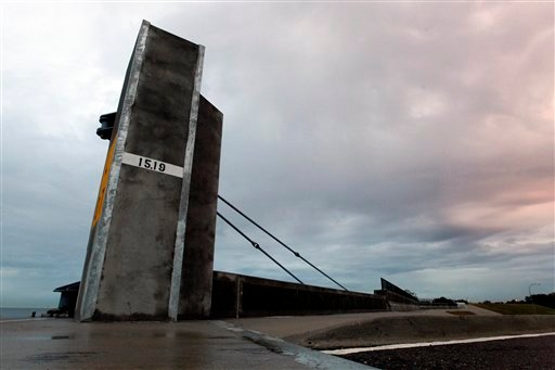 © This Nov. 26, 2012, photo shows a flood wall and floodgate along Lakeshore Drive and Lake Pontchartrain in New Orleans.