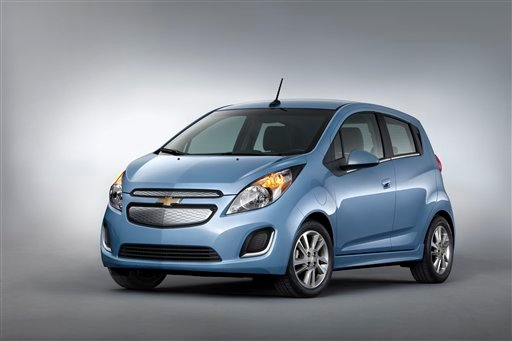 © This undated image provided by General Motors shows the 2014 Chevrolet Spark EV, which will be unveiled at the 2012 Los Angles Auto Show during the week of Nov. 26, 2012. The five-door urban mini car is priced at under $25,000 with tax incentives.