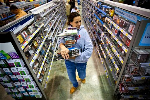 FILE -In this Friday, Nov. 23, 2012, file photo, Tonya Thomas, of Russellville, Ky., makes her way through the aisles at Best Buy in Bowling Green, Ky. (AP Photo/Daily News, Alex Slitz)