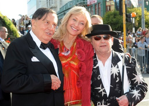 "Cast members Barry Humphries, left, who plays Great Goblin, his wife Lizzie Spender, Sylvester McCoy who plays Radagast, on the red carpet at the premiere of ""The Hobbit: An Unexpected Journey,"" in New Zealand Nov. 28, 2012. (AP Photo/SNPA, Ross Setford)"