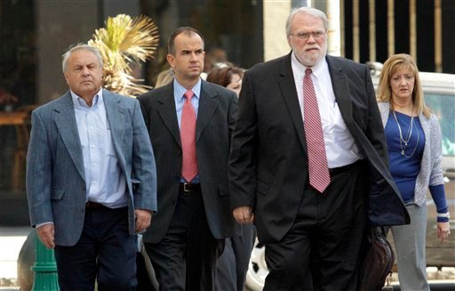 Donald Vidrine, left, a BP well site leader from the Deepwater Horizon oil rig explosion, arrives with his legal team at Federal Court before he is arraigned on manslaughter charges in New Orleans, Wednesday, Nov. 28, 2012. (AP Photo/Matthew Hinton)