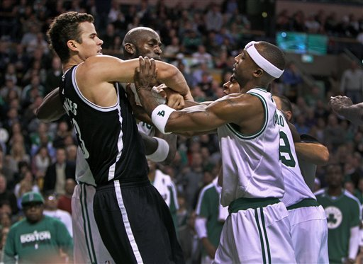Boston Celtics' Kevin Garnett, center, Rajon Rondo, front right and Jason Terry (partially obscured, back right, confront Brooklyn Nets' Kris Humphries, front left, during an NBA game in Boston, Wednesday, Nov. 28, 2012. (AP Photo/The Globe/Jim Davis)