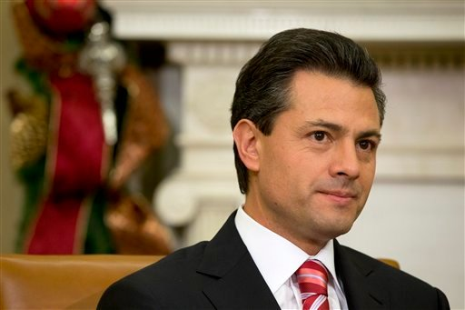 Mexico's President-elect Enrique Pena Nieto listens as President Barack Obama speaks prior to their meeting in the Oval Office of the White House in Washington, Tuesday, Nov. 27, 2012.