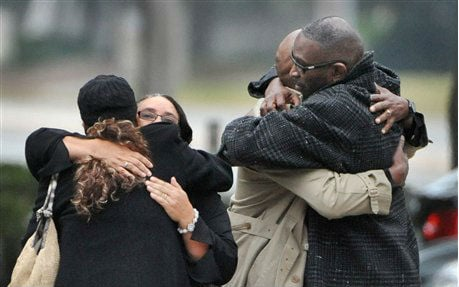 © Ron Davis, the father of Jordan Davis is embraced as he arrives at the funeral home for the visitation and a memorial service for his son Jordan, Wednesday, Nov. 28, 2012 in Jacksonville, Fla.