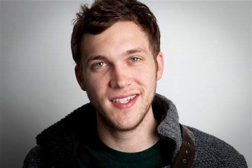 © In this Tuesday, Nov. 13, 2012 photo, American singer-songwriter and winner of the eleventh season of American Idol, Phillip Phillips, Jr. poses for a portrait in New York.
