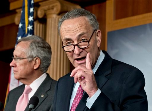 © Sen. Charles Schumer, D-N.Y., right, accompanied by Senate Majority Leader Harry Reid of Nev., gestures during a news conference on Capitol Hill in Washington, Thursday, Nov. 29, 2012, after talks with Treasury Secretary Timothy Geithner.
