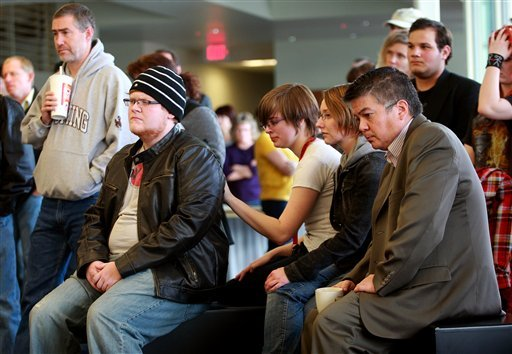 Students and staff listen to a news conference after an apparent murder-suicide on campus Friday, Nov. 30, 2012 at Casper College in Casper, Wyo.  (AP Photo/The Casper Star-Tribune, Alan Rogers)