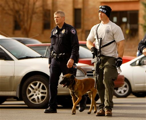 © Casper police leave the Wold Physical Science Building while investigating a murder and suicide at Casper College, Friday Nov. 30, 2012, in Casper, Wyo. Two people were killed by a sharp object, according to Casper police.