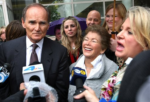 Lois Goodman, center, a tennis umpire accused of fatally bludgeoning her 80 year old husband addresses the media with her attorneys, Robert Sheahen, left, and Alison Triessl, right, Friday, Nov. 30, 2012 in Van Nuys, Calif.  (AP Photo/Los Angeles Times)