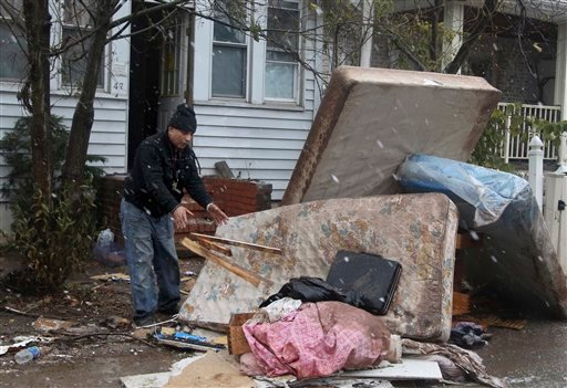 © Eddie Saman cleans out his house, which was damaged by Superstorm Sandy, as it begins to snow in the New Dorp section of Staten Island, New York, Wednesday, Nov. 7, 2012.