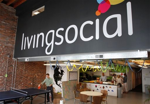© In this April 29, 2011 photo, Ross Arbes, 24, left, plays ping pong while on break at LivingSocial's offices in Washington.