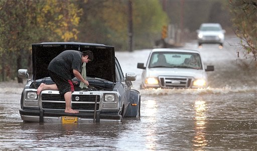© Milton Lopez of Windsor, Ca. USA attempted to drive through flood waters on Mark West Station Road at Starr Road, Friday, Nov. 30, 2012 in Windsor, Calif.