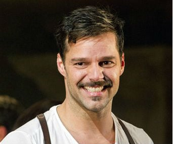 "© In this Monday, March 12, 2012 photo, Ricky Martin appears at the curtain call after his first performance in the new Broadway production of ""Evita"", in New York."