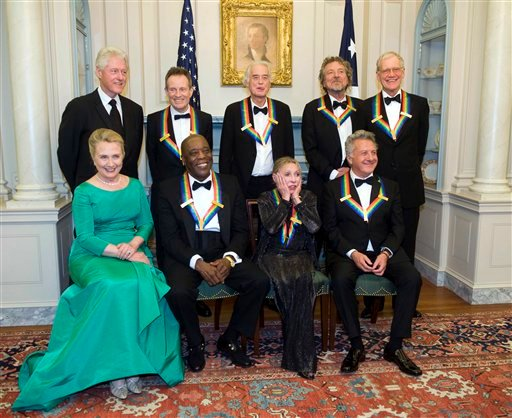© 2012 Kennedy Center Honoree Natalia Makarova, front row, second right, reacts to all the photos being taken during a group photo after the State Department Dinner for the Kennedy Center Honors gala Saturday, Dec. 1, 2012.