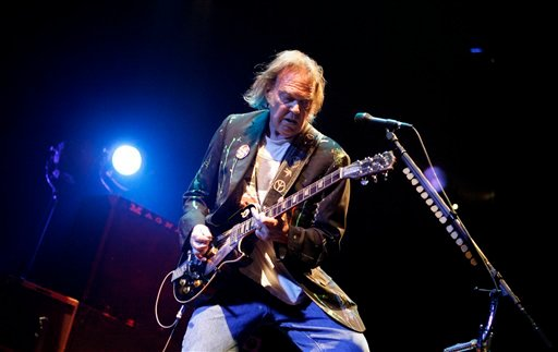 ©  In this Monday, Dec. 15, 2008, file photo, Neil Young performs at Madison Square Garden in New York.