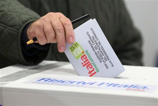 © A man casts his vote during a primary runoff, in Piacenza, Italy, Sunday, Dec. 2, 2012. Italians are choosing a center-left candidate for premier for elections early next year, an important primary runoff given the main party is ahead in the polls.