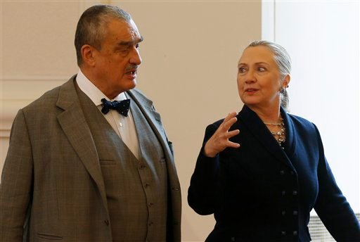 Czech Republic's Foreign Minister Karel Schwarzenberg, left, and US Secretary of State Hillary Rodham Clinton, right, arrive for their press conference in Prague, Czech Republic, Monday, Dec. 3, 2012. (AP Photo/Petr David Josek)