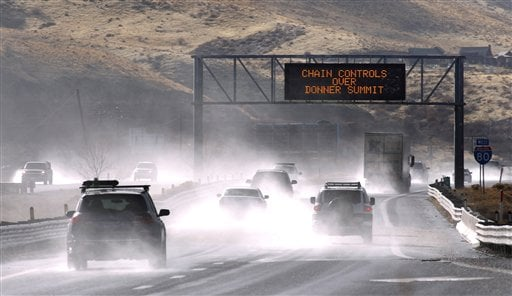 Traffic moves west along Interstate 80 west of Reno, Nev., as a heavy, wet storm hits Northern Nevada on Sunday, Dec. 2, 2012. (AP Photo/Cathleen Allison)