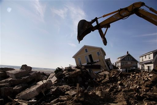 © In this Nov. 29, 2012, file photo, clean up continues on the site of a demolished home on the Rockaway Peninsula in New York.