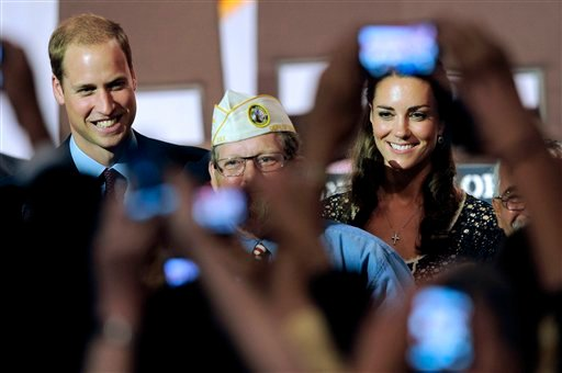 © In this July 10, 2011, file photo, Prince William and wife Kate, the Duke and Duchess of Cambridge, are photographed by fans during a visit to the U.S. in Culver City, Calif.
