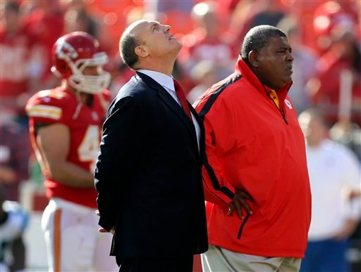 © Kansas City Chiefs general manager Scott Pioli, left, and coach Romeo Crennel stand together before an NFL football game against the Carolina Panthers at Arrowhead Stadium in Kansas City, Mo., Sunday, Dec. 2, 2012.
