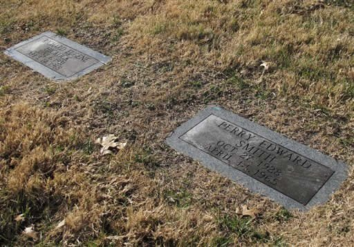 The graves of Perry Edward Smith, right, and Richard Eugene Hickock, left, sit on a sloping hillside at the Mount Muncie Cemetery, Tuesday, Dec. 4, 2012, in Lansing, Kan. (AP Photo/John Hanna)