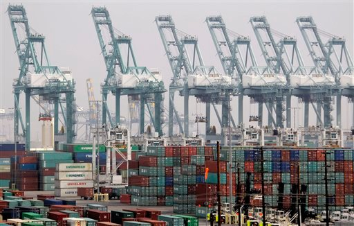 Shipping containers are seen as port operations are halted during a strike at the Port of Los Angeles Tuesday, December 4, 2012.  (AP Photo/Nick Ut)